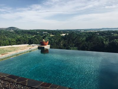 Looking out over the pool to the lake and stunning hill views!