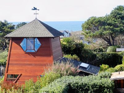 Photo for Sweeping ocean views nestled in exquisite private garden