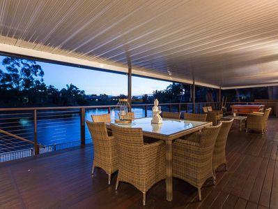 Relax on the deck overlooking the waterway