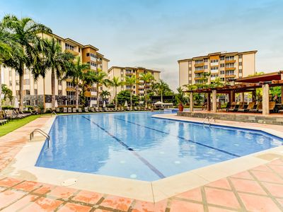 Photo for Modern condo with shared pool and great location near town and beach