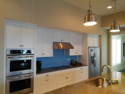 Custom kitchen with stainless steel appliances and granite countertops