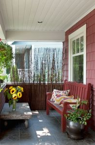 Front porch that faces beautiful tree-lined street