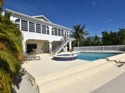Photo for Canal Front Vacation Home Featuring Heated Pool, Jacuzzi and 60' Slip