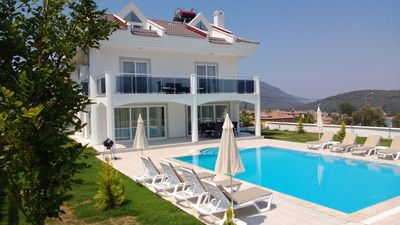 Pool with sun loungers & parasols