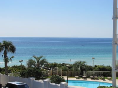 View across the pool to the Gulf from the 2 decks of this 3 story,1850 sqft home