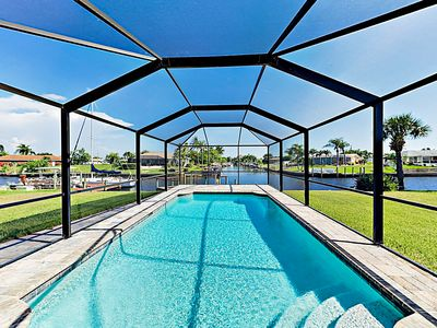 Photo for Canal-Front w/ Screened Saltwater Pool, Dock & Boat Lift - Updated Interior!