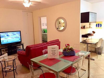 Villa features open living area and has HDTV and dining for four.