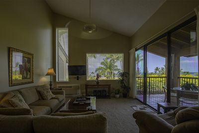 Living room, with view of the lanai and picture window with stunning views.