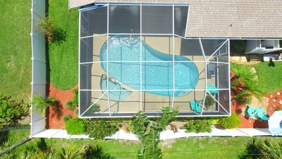 The yard has privacy  fencing and landscape. The salt pool and spa are heated!