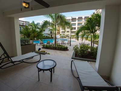 Photo for Sleek and Elegant Condo, Lovely Terrace steps from Pool, Great for Families