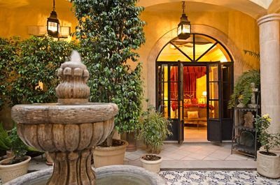 Your bedroom, seen here, opens directly onto the central tree-filled courtyard.