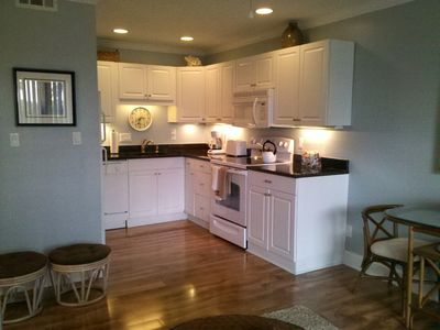 Renovated kitchen with granite counter tops, full size appliances & dishwasher.