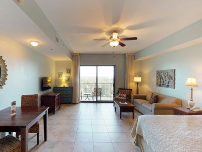 Photo for Bright Origin condo with a shared pool and hot tub, beach across the street!