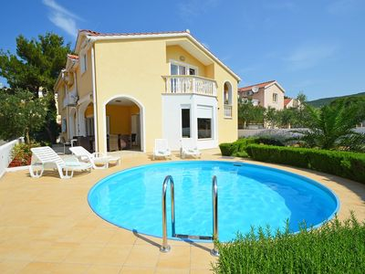 Photo for This 5-bedroom villa for up to 10 guests is located in Vodice and has a private swimming pool, air-c