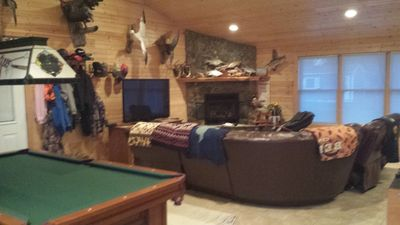 Great room with gas fireplace, pool, ping pong and fooseball tables