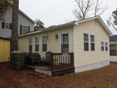 Photo for Pet friendly, W/D, wi-fi and cable TV, 2 bedroom cottage with golf cart, sleeps