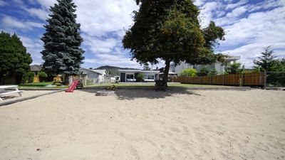 Photo for 3 Bedroom Quaint Lakefront Home Steps from Beautiful Downtown Kelowna