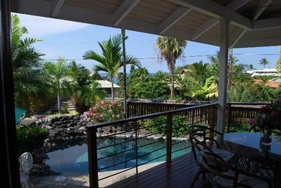 The house opens up onto a Lanai, which overlooks the pool and waterfall.