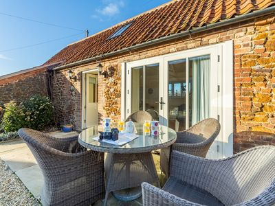 Photo for A fabulous award-winning bijou barn conversion in the quiet village of Ringstead