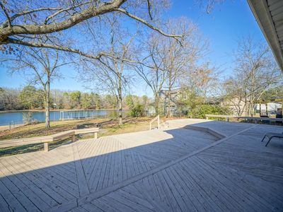 Updated one level Lake Hamilton home on flat lot with large deck and boat dock!