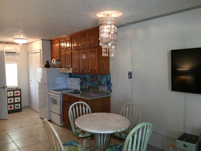 Kitchen with Granite Counter tops and Custom Ocean Motif Back Splash Dining area