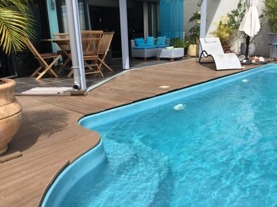 Photo for Villa Plumeria, feet in the water with sea and mountain views
