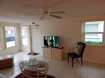 Living Room with One of Three Flat Screen TVs