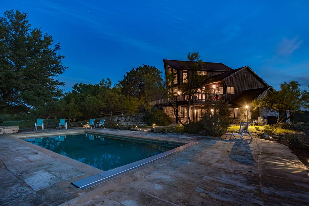 Texas cabin rental with a huge pool and hot tub