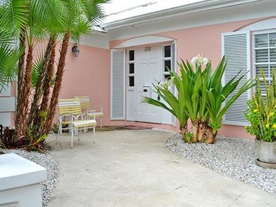 Photo for Stately Naples charm, only steps to 5th Ave and the beach!