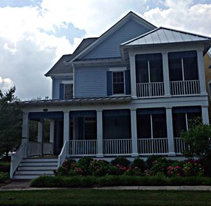 Front of house, June 2013, 3 screened porches, veranda, lush landscaping