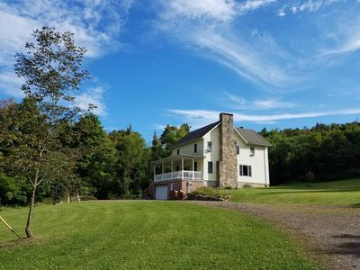 Photo for Renovated farmhouse on 10 serene acres with spring-fed stocked pond and creeks