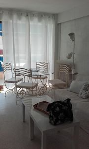 Photo for Superb south west facing apartment with garage just 20 metres from the beach