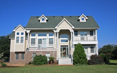 Photo for At The Turn: Spacious 6 bedroom home with keyless entry, game room, private pool and hot tub!