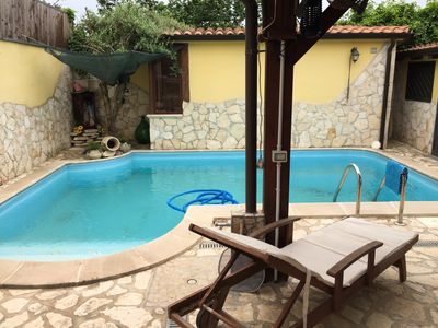 Photo for Homerez last minute deal - Nice villa with pool access and Wifi
