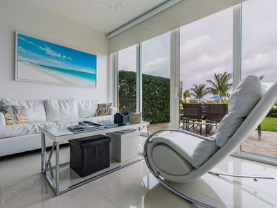 Photo for Relax from your Jacuzzi looking at the Caribbean. Ground Floor Ocean View Condo. Blue-114