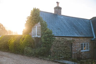 The Brew House forms the east wing of the Grade II listed Knighton Farmhouse