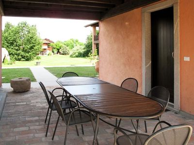 Photo for Lovely apartment in villa for 4 guests with WIFI, pool, A/C, TV, balcony, pets allowed and parking