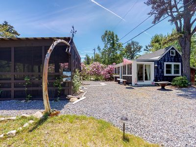 Photo for NEW LISTING! Quaint cottage w/ beautiful interior design & outdoor kitchen!