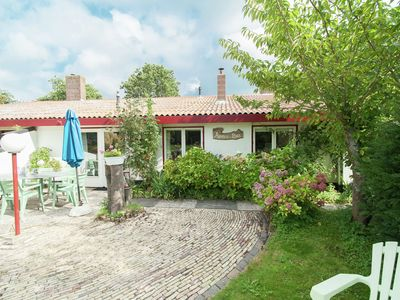 Photo for Atmospheric holiday home surrounded by woods and dunes in a great location