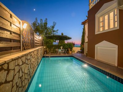 Photo for In order to access Villa Sfakaki, you will have to walk down its private drive. This contemporary th