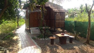 Photo for Zuperb basic and clean wooden cottages in Austins farm with a pool amidst nature