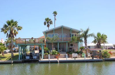 Photo for Enjoy coastal breezes and water views from the large deck and covered patios of this completely remo