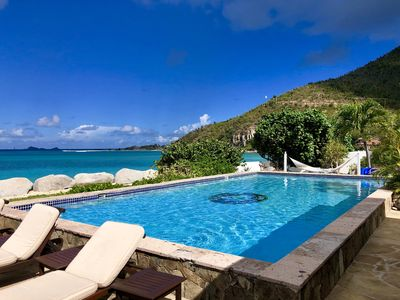 Photo for Luxurious Beach front 4 bedroom villa located on Mahoe Bay in Virgin Gorda, BVI