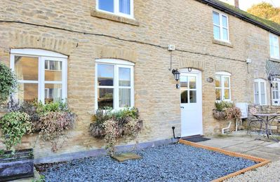 Photo for Primrose Cottage is a beautiful Cotswold stone cottage, with a peaceful courtyard garden