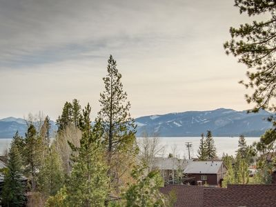 Photo for Comfortable family condo w/ shared pool, hot tub, & tennis - lovely lake views!