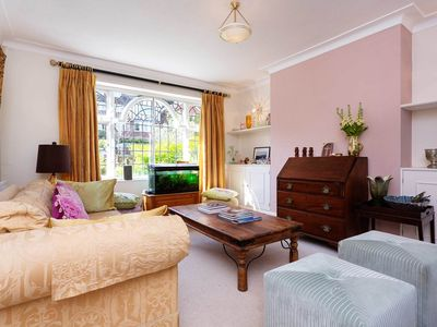 Photo for Spacious family home near Richmond Park, garden and off-street parking by Veeve