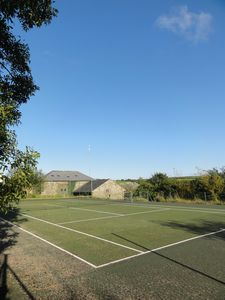 The tennis court is 30 paces away and is free. It's also great for kids just wanting to kick a ball about.