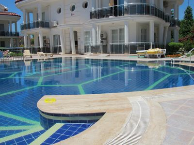 Photo for Ground Floor Apartment on a private complex with gardens and swimming pool