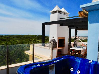 Photo for Villa in Praia Verde - Terrace with Jacuzzi