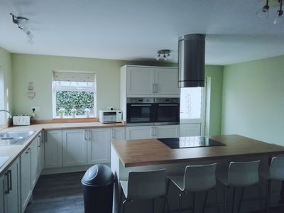 Kitchen with 5 ring hob and double ovens